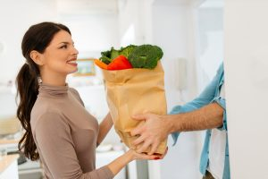 Smart,Food,Delivery,Service,Man's,Hands,Holding,Paper,Bag,With